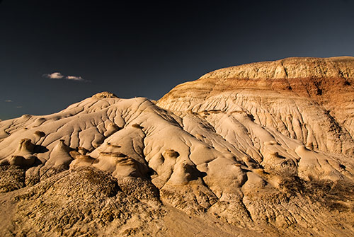 Sunset aon sandstone formations at DeNa Zin Wilderness